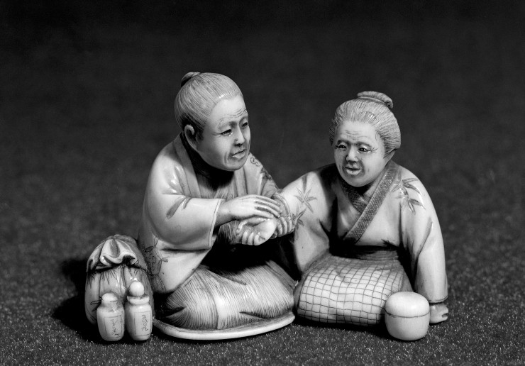 L0004642 Japanese model figures: doctor and patient Credit: Wellcome Library, London. Wellcome Images images@wellcome.ac.uk http://wellcomeimages.org Doctor and Patient. A doctor feeling the pulse of a woman patient; both seated on their heels, side by side. Carved ivory netsuke, Japanese. Published:  -  Copyrighted work available under Creative Commons Attribution only licence CC BY 4.0 http://creativecommons.org/licenses/by/4.0/